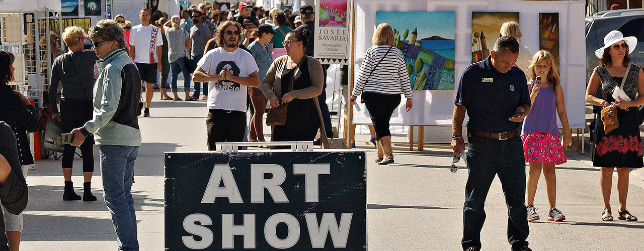 People walking on the street during an outdoor art show