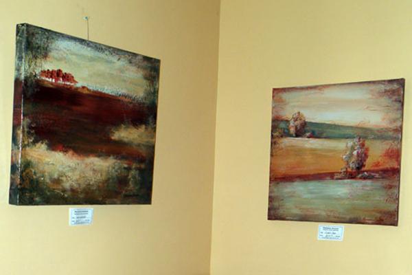 2 paintings in a corner