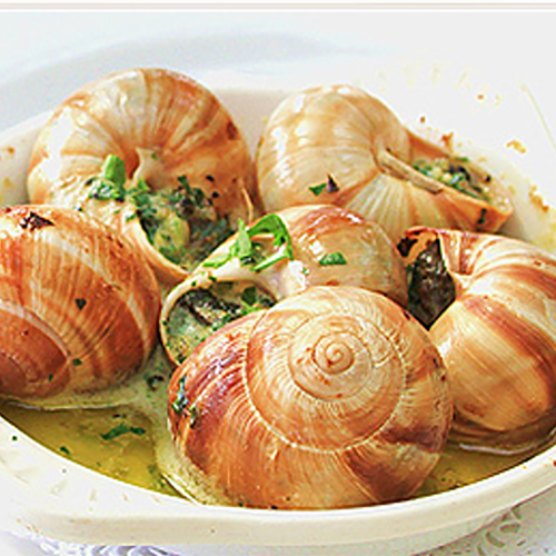 Snails in a bowl with butter